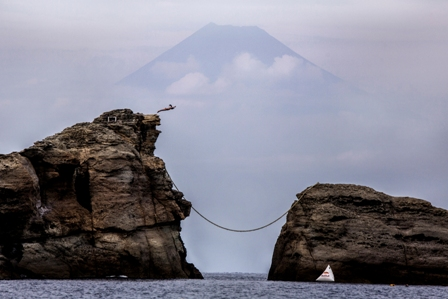 Orlando Duque of Colombia dives 15 metres from Ushitsuki Iwa (Bull's Rock) in Shizuoka, the home of Mount Fuji, prior to the eighth stop of the Red Bull Cliff Diving World Series in Kumomi, Japan on October 13, 2016.